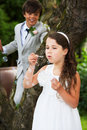 Page Boy And Bridesmaid Blowing Bubbles Royalty Free Stock Image - 33082956