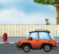A Car At The Road And A Cat Above The Fence Royalty Free Stock Photography - 33096897