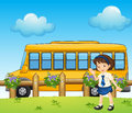 A Student And The School Bus Stock Photo - 33097650