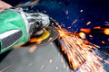 Heavy Industry Worker Cutting Steel With Angle Grinder Stock Photo - 33122590