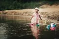 Little Girl Plays With Paper Boats Stock Image - 33126761