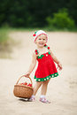 Little Girl With Basket Full Of Strawberries Royalty Free Stock Image - 33126816