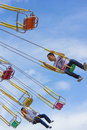 Unidentified People On The Chain Swing Carousel Stock Image - 33156331