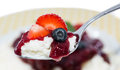 Rice Pudding With Fruits On A Spoon Royalty Free Stock Photos - 33158728