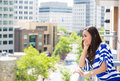 Beautiful Young Female Relaxing On A Balcony On A Sunny Summer Day, In Her New Apartment Stock Photo - 33170800