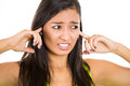 Young Unhappy, Stressed Woman Covering Her Ears Looking Away, As If To Say, Stop Making That Loud Noise It S Giving Me A Headache Stock Photos - 33170933