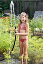 Joyful Girl With Garden Hose And Water Royalty Free Stock Photos - 33179868