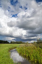 Storm Clouds Over River Stock Photos - 33180643