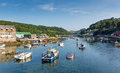 Boats On Looe River Cornwall England Blue Sea And Sky Royalty Free Stock Image - 33187126