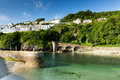 Looe Harbour Wall Cornwall England With Blue Green Sea Royalty Free Stock Image - 33187356