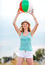 Girl Playing Ball On The Beach Stock Photography - 33188042