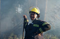 African Female Firefighters Helped Extinguish A Bush Veld Fire Allegedly Started By Shorting Power Lines In Hilton, Pietermaritzbu Stock Image - 33190831