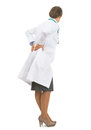 Full Length Portrait Of Doctor Woman With Back Pain Royalty Free Stock Photography - 33196237