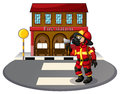 A Fireman In Front Of The Fire Station Royalty Free Stock Images - 33202989