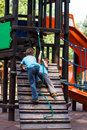 Little Brothers Playing On Jungle Gym Stock Images - 33213944