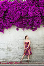 Woman And Violet Flowers Above Her Stock Images - 33223164