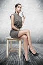 Sexy Brunette Woman Sitting On Stool Stock Photography - 33230362