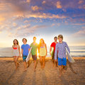 Surfers Boys And Girls Group Walking On Beach Royalty Free Stock Photo - 33309975