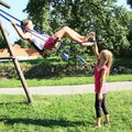 Little Kids - Girls Playing On Swing Stock Photography - 33316892