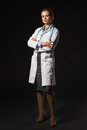 Full Length Portrait Of Serious Doctor Woman On Black Background Royalty Free Stock Images - 33316979