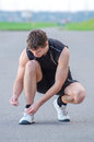 Man Tying His Sport Shoes Royalty Free Stock Photos - 33319358