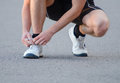 Man Tying His Shoes Stock Photo - 33319360