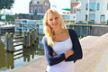 Girl On The Waterfront In The Dutch Town Of Gorinchem. Royalty Free Stock Photos - 33335838