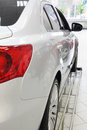 Back Red Lights Of New White Shining Car Standing In Office Royalty Free Stock Image - 33336836