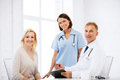 Doctor And Nurse With Patient In Hospital Stock Photos - 33338243