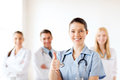 Doctor With Group Of Medics Showing Thumbs Up Royalty Free Stock Photos - 33339008