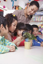 Students Looking At Plant With A Magnifying Glass Royalty Free Stock Photos - 33372988