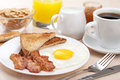 Traditional Breakfast With Fried Egg And Bacon Stock Images - 33383734