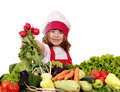 Little Girl Cook With Radish And Vegetables Stock Photography - 33385602