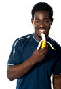 Young Fit Guy Eating Banana Stock Images - 33391264