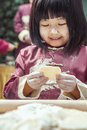 Portrait Of Little Girl Making Dumplings In Traditional Clothing Royalty Free Stock Photography - 33394297