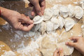 Senior Woman And Girl Making Dumplings, Hands Only Stock Photography - 33394362