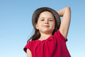 Cute Little Girl Outside Wearing A Red Shirt And A Hat Stock Images - 33421374