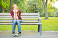 A Woman Waiting On A Bench In A Park Stock Image - 33424221
