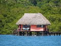 Thatched Cabin Above The Sea Stock Photo - 33442480