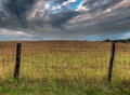 Fenceline And Dramatic Clouds Stock Images - 33443404