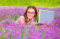 Pretty Woman With Laptop On Floral Field Royalty Free Stock Images - 33445329