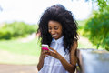 Outdoor Portrait Of A Teenage Black Girl Using A Mobile Phone - Stock Photos - 33447233