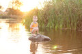 Little Boy On A Rock In The Lake At Sunrise Royalty Free Stock Images - 33453619