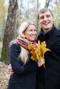 Happy Husband And Wife With Yellow Maple Leafle Laugh Royalty Free Stock Photos - 33462748