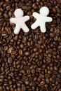 Multicolored Sugar In The Form Of Little Men On The Coffee Beans Royalty Free Stock Photos - 33470108