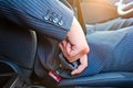 Driver  In Business Suit Fastens His Seat Himself Automobile Seat Belt Royalty Free Stock Photography - 33472077