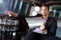 Handsome Man Reading Newspaper In Limousine Stock Images - 33481664