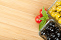 Olives, Tomatoes And Basil On Cutting Board Stock Photography - 33492422