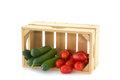 Cucumbers And Tomatoes In A Wooden Crate Stock Photos - 33504573
