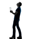 Man Holding Digital Tablet  Looking Up Silhouette Stock Photos - 33505523